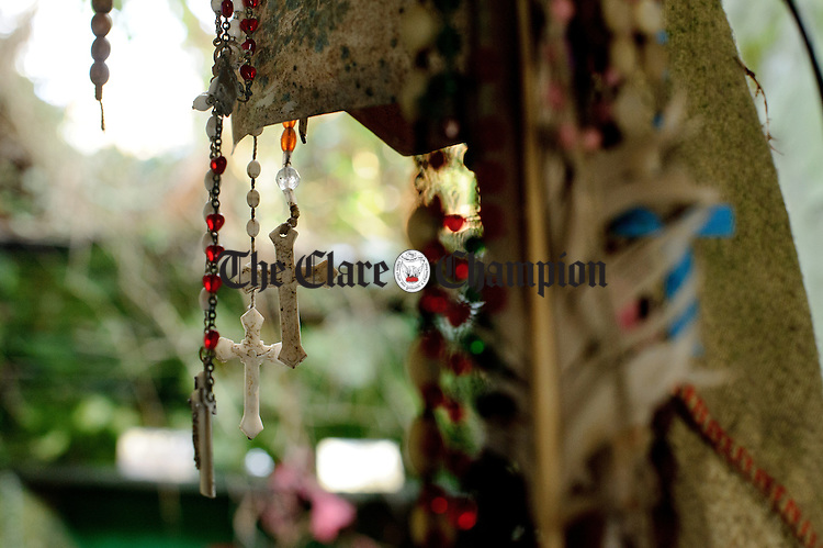 Crucifixes on rosary beads hang from the ceiling during the annual celebration at St Bridget's Well. Photograph by John Kelly.