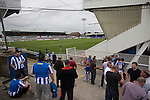Supporters of Hartlepool United enjoying a pre-match drink inside the Victoria Ground, Hartlepool, before the pre-season friendly between the home team and Middlesbrough. Hartlepool were relegated to League Two at the end of the 2012-13 season whilst their Teesside neighbours remained two divisions above them in the Championship. The game ended in a no-score draw, the home team's goalkeeper Scott Flinders saving a second-half penalty from Boro's Lucas Jutkiewicz, watched by a crowd of 2307.