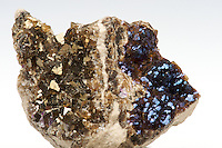 Fluorite - brown crystals with two different colors of iridescence in the same hand specimen (gold and blue, with a little bit of magenta). This iridescence is caused by a micro coating of hydrocarbons on the surfaces of the crystals. Stoneco Auglaize Quarry, Paulding County, Junction, Ohio.