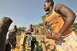 Women get water from a well in the Southern Sudan village of Kupera. Families here returned from refuge in Uganda in 2006 following the 2005 Comprehensive Peace Agreement between the north and south. The well was installed by Catholic Relief Services (CRS). NOTE: In July 2011, Southern Sudan became the independent country of South Sudan
