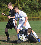 BEACON FALLS  CT. - 15 October 2019-101519SV11- Goal keeper Noah Kondic of Oxford High makes a save as #12 Alexander Farr of Woodland and #4 Jaden Schupp of Oxford High got close to the goal during NVL soccer action in Beacon Falls Tuesday. <br />Steven Valenti Republican-American
