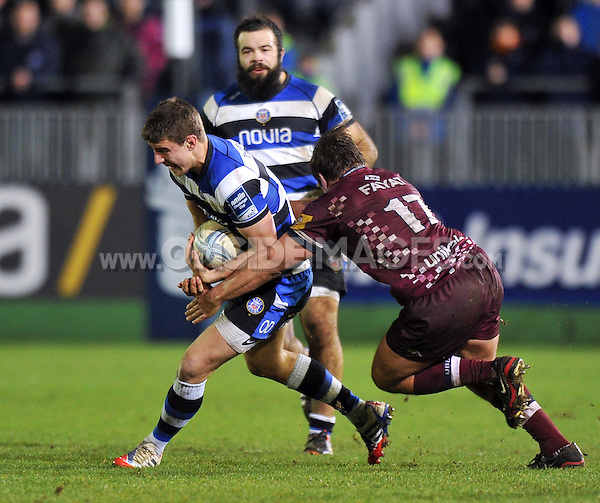 Ollie Devoto in possession. Amlin Challenge Cup match, between Bath Rugby and Bordeaux-Begles on January 16, 2014 at the Recreation Ground in Bath, England. Photo by: Patrick Khachfe / Onside Images