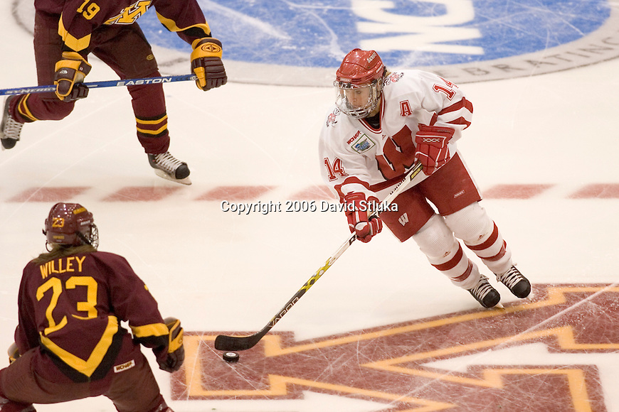 MINNEAPOLIS, MN - MARCH 26: Nikki Burish #14 of the Wisconsin Badgers women's hockey handles the puck against the Minnesota Golden Gophers at Mariucci Arena during the Women's Frozen Four Tournament final on March 26, 2006 in Minneapolis, Minnesota. The Badgers beat the Gophers 3-0. (Photo by David Stluka)