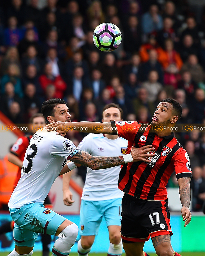 Joshua King of AFC Bournemouth right and Jose Fonte of West Ham United vie for the ball during AFC Bournemouth vs West Ham United, Premier League Football at the Vitality Stadium on 11th March 2017