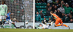 Tony Watt knocks the ball past St Johnstone keeper Alan Mannus to put Celtic briefly ahead as Frazer Wright attempts to hook it back out