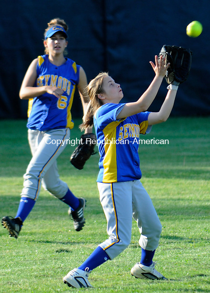 WOLCOTT, CT-24 MAY 2010-052410IP03- Seymour High School's Kim Tirita makes a catch in the outfield with backup from Amanda Willette during their game against Torrington High School in Wolcott on Monday. Seymour won 7-1.                                                                                                                                                                                                                                                                                                                                                                                                                                                                                                                                                                                                                                                                                                                                                                                                                                                                                                                                                                                                                                                                                                                                                                                                                                                                                                             <br /> Irena Pastorello Republican-American