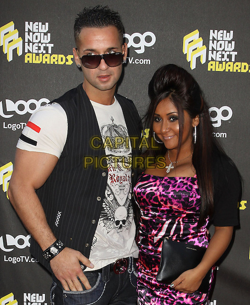 MIKE SORRENTINO (aka THE SITUATION) & NICOLE POLIZZI (aka SNOOKI) .Logo's NewNowNext Awards 2010 held at The Edison, Los Angeles, CA, USA..June 8th, 2010.half length jersey shore michael black waistcoat white t-shirt sunglasses shades clutch bag purple pink silk satin leopard print dress.CAP/ADM/KB.©Kevan Brooks/AdMedia/Capital Pictures.