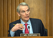 United States Senator Rob Portman (Republican of Ohio) questions US Secretary of the Treasury Steven Mnuchin as he testifies before the United States Senate Committee on Finance on the President's Fiscal Year 2019 budget on Capitol Hill in Washington, DC on Wednesday, February 14, 2018.<br /> Credit: Ron Sachs / CNP