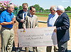 Presentation of donation check to the PDJF at Delaware Park on 8/22/15  <br /> Check accepted by Ramon Dominguez on behalf of PDJF.  <br /> Donated from The Casino at Delaware Park, The Eastern Arabian Racing Alliance, Delaware Thoroughbred Horseman's Assoc. & The Delaware Jockey's Health & Welfare Fund