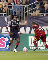 New England Revolution midfielder Kenny Mansally (7) considers defender Real Salt Lake midfielder Ned Grabavoy (20). Real Salt Lake defeated the New England Revolution, 2-1, at Gillette Stadium on October 2, 2010.
