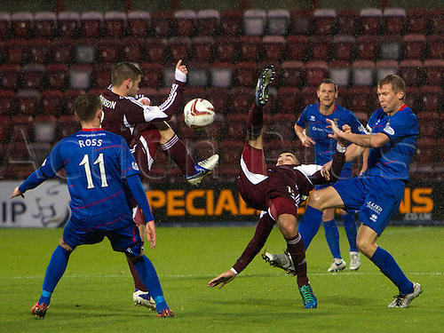 14.12.2013. Edinburgh, Scotland.  Hearts Scott Robinson and Callum Paterson go for the ball during the Clydesdale Bank, Scottish Premier League game  between  Heart Of Midlothian and Inverness Caledonian Thistle, from Tynecastle Stadium.