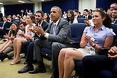 United States President Barack Obama, center, claps as he watches the USA v. Belgium World Cup game with staff members at the Eisenhower Executive Office Building next to the White House in Washington, D.C., U.S., on Tuesday, July 1, 2014. The U.S. is tied 0-0 with Belgium in a match to decide who meets Argentina in the quarterfinals of soccer's World Cup in Brazil. <br /> Credit: Andrew Harrer / Pool via CNP