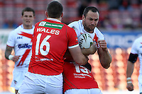 PICTURE BY ALEX WHITEHEAD/SWPIX.COM - Rugby League - Autumn International Series - Wales vs England - Glyndwr University Racecourse Stadium, Wrexham, Wales - 27/10/12 - England's Adrian Morley is tackled by Wales' Joe Burke and Ben Flower.