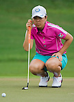 CHON BURI, THAILAND - FEBRUARY 17:  Mika Miyazato of Japan lines up a putt on the 9th green during day two of the LPGA Thailand at Siam Country Club on February 17, 2012 in Chon Buri, Thailand.  Photo by Victor Fraile / The Power of Sport Images