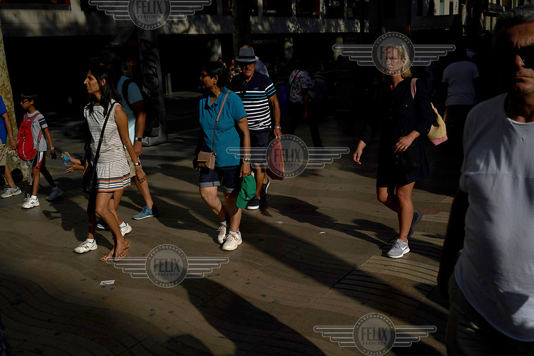 Tourists and locals return to La Rambla ( Las Ramblas ) where a van driven by Younes Abouyaaqoub drove into crowds of pedestrians, killing 14 and wounding dozens on 17 August. He fled the scene but was tracked down by police and shot dead on 21 August near Barcelona. <br /> The Spanish prime minister called the event &quot;a jihadist attack&quot; and the Islamic State (ISIS) claimed responsibility.