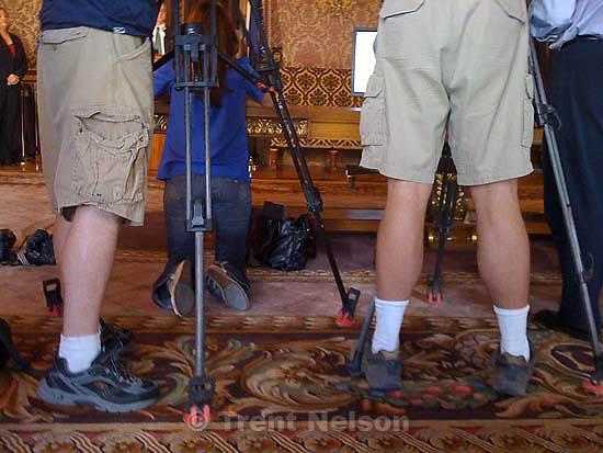 tv news cameramen in shorts, capitol press conference
