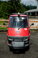 a three wheeled Vespa Piaggio APE 50 vehicle in Pragelato in the Piedmont region (Italy, 16/06/2010)