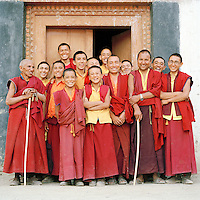 Buddhist monks in the doorway of their monastery, Ladakh, India