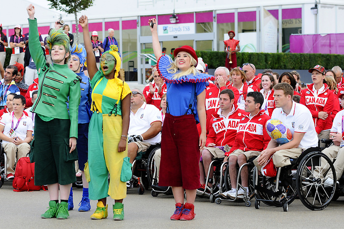 London, England 26/08/2012 - Team Canada enjoys a performance in the Paralympic Village Plaza during the flag raising ceremony at the London 2012 Paralympic Games. (Photo: Phillip MacCallum/Canadian Paralympic Committee)