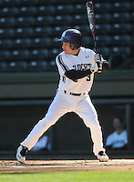 Shortstop Trevor Stevens (3) of the Northwestern Wildcats hits in a game against the Michigan State Spartans on Sunday, February 17, 2013, at Fluor Field at the West End in Greenville, South Carolina. Michigan State won, 7-4. (Tom Priddy/Four Seam Images)