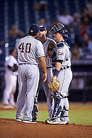 Lakeland Flying Tigers pitching coach Jorge Cordova (40) talks with pitcher Gage Smith (19) and catcher Kade Scivicque (28) during a game against the Tampa Yankees on April 8, 2016 at George M. Steinbrenner Field in Tampa, Florida.  Tampa defeated Lakeland 7-1.  (Mike Janes/Four Seam Images)