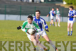 Ballydonoghue's Eddie Sheehy pulls away from Templenoe'sSean Sheehan in the 1st round of the Novice Championship at Ballydonoghue on Saturday.