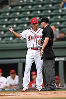 Manager Iggy Suarez (2) of the Greenville Drive argues with home plate umpire Matt Baldwin during a game against the Hickory Crawdads on Monday, August 20, 2018, at Fluor Field at the West End in Greenville, South Carolina. Hickory won, 11-2. (Tom Priddy/Four Seam Images)
