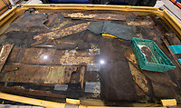 BNPS.co.uk (01202 558833)<br /> Pic: PhilYeomans/BNPS<br /> <br /> The wood and rope finds are being conserved in water at the MAST facility in Poole.<br /> <br /> Fascinating artefacts salvaged from a historic gun ship which sunk off the British coast 261 years ago have gone on display for the first time.<br /> <br /> The French built ship is credited with transforming the Georgian Royal Navy after its capture in 1747 when trials revealed it was sleeker and better armed than British warships of the day.<br /> <br /> Unfortunately HMS Invincible  became wrecked on a shallow sand bank in the Solent in 1758 when en route to fhelp fight the French in Canada.<br /> <br /> The wreck, which is three nautical miles from Portsmouth, Hants, was first discovered by a fisherman in shallow 25ft waters 40 years ago. However, changing sea bed levels in the past few years have left it more exposed to the elements, leading to fears the relics could deteriorate.<br /> <br /> This prompted archaeologists to carry out a full scale excavation, with 1,458 dives taking place between 2017 and 2019 - during which nearly 2,000 artefacts were recovered.<br /> <br /> The array of new finds, including the ship's enormous cutwater - the forward curve of the ship's stem - have now been unveiled at the MAST Archaeological Centre in Poole, Dorset. They will eventually go on display at the National Museum of the Royal Navy in Portsmouth.<br /> <br /> Mr Pascoe said the HMS Invincible's innovative longer, streamlined design was copied by the British who adopted it on their ships up until the Battle of Trafalgar (1805).