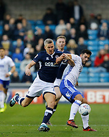 Steve Morison of Millwall tussles with Maxime Colin of Birmingham City during the Sky Bet Championship match between Millwall and Birmingham City at The Den, London, England on 21 October 2017. Photo by Carlton Myrie.