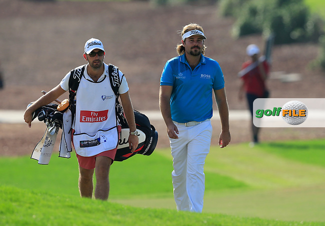 Victor Dubuisson (FRA) on the 13th fairway during Round 1 of the DP World Tour Championship at the Earth course,  Jumeirah Golf Estates in Dubai, UAE,  19/11/2015.<br /> Picture: Golffile | Thos Caffrey<br /> <br /> All photo usage must carry mandatory copyright credit (&copy; Golffile | Thos Caffrey)