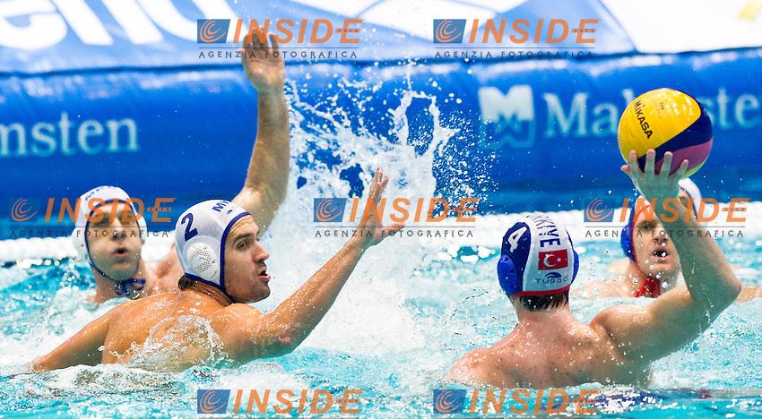 Eindhoven , Netherlands (NED) 16/1/2012.LEN European  Water Polo Championships 2012.Day 01 - .Macedonia (White) - Turkey (Blue)..MKD.2.RACUNICA Igor..TUR.4.OKMAN Oytun...Photo Insidefoto / Giorgio Scala / Deepbluemedia