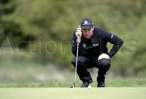 13 May 2005: English golfer Brian Davis lines up a putt during the second round of the The Daily Telegraph Dunlop Masters played at the Forest of Arden, Warwickshire. Photo: Neil Tingle/Actionplus..050513 golf golfer player green