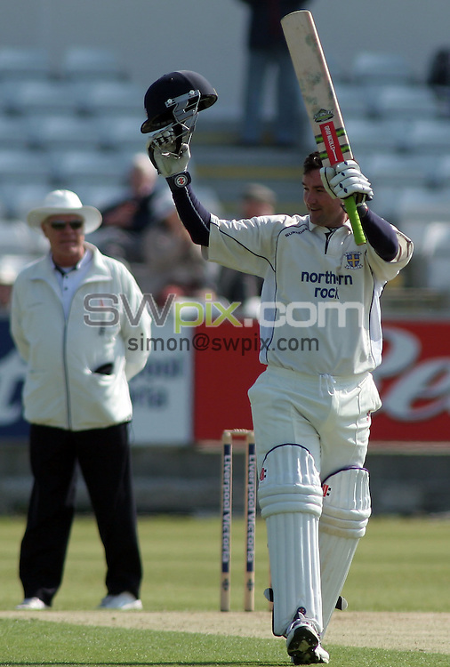 PICTURE BY VAUGHN RIDLEY/SWPIX.COM -  Cricket - Liverpool Victoria County Championship Division One- Riverside, Chester-le-Street, County Durham - 10/05/06...? Simon Wilkinson - 07811 267706...Durham's Jimmy Maher salutes the crowd as he celebrates his 1st inning century.