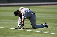 Third baseman Oswaldo Cabrera (10) of the Charleston RiverDogs reflects before a game against the Greenville Drive on Sunday, April 29, 2018, at Fluor Field at the West End in Greenville, South Carolina. Greenville won, 2-0. (Tom Priddy/Four Seam Images)