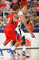 21 January 2012:  FIU guard Phil Taylor (11) handles the ball while being defended by FAU guard Raymond Taylor (2) in the second half as the Florida Atlantic University Owls defeated the FIU Golden Panthers, 66-64, at the U.S. Century Bank Arena in Miami, Florida.
