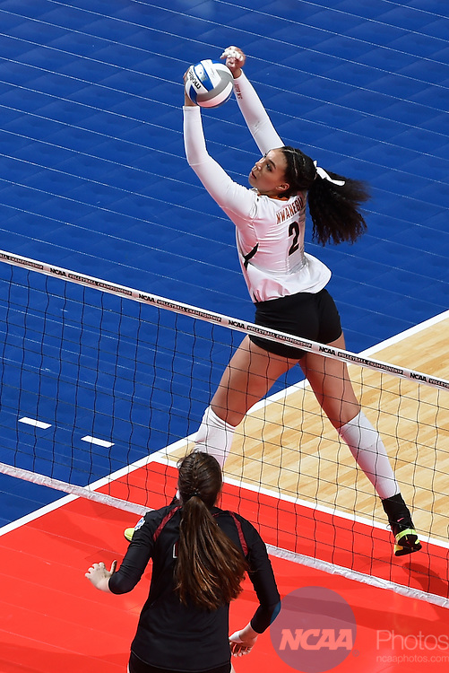 COLUMBUS, OH - DECEMBER 17:  Ebony Nwanebu (2) of the University of Texas returns a serve against Stanford University during the Division I Women's Volleyball Championship held at Nationwide Arena on December 17, 2016 in Columbus, Ohio.  Stanford defeated Texas 3-1 to win the national title. (Photo by Jamie Schwaberow/NCAA Photos via Getty Images)