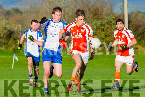 Timmy Finnegan Brosna drives past Keel Emmet Ashe during their Intermediate Championship relegation play off in Castleisland on Saturday