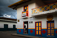 A brightly painted colonial house is seen before a rain storm in Jardín, a village in the coffee region (Zona cafetera) of Colombia, 24 April 2018.