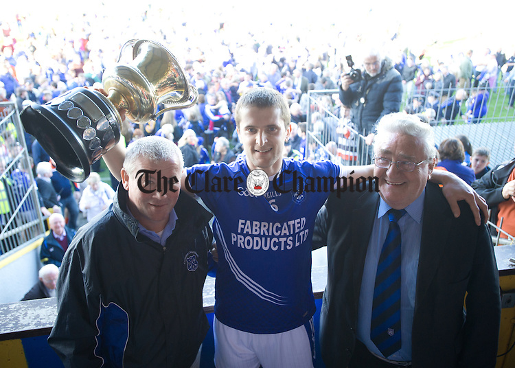 Micheal Hawes of Cratloe was presented with the Jack Daly Cup by Jack Chaplin, club county board delegate and John Ryan, club chairman,  following their senior football final at Cusack park. Photograph by John Kelly.