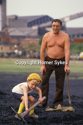 Miners strike 1984. Shirebrook Colliery Derbyshire. Striking Miners have to scavenge for coal. Miner and son.