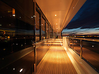 As the sun disappears over the horizon recessed lights illuminate the teak-decked walkways around the vessel