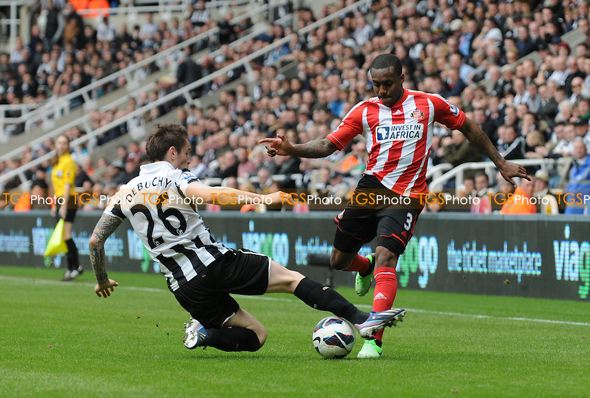 Mathieu Debuchy of Newcastle United tackles Danny Rose of Sunderland - Newcastle United vs Sunderland - Barclays Premier League Football at St James Park, Newcastle upon Tyne - 14/04/13 - MANDATORY CREDIT: Steven White/TGSPHOTO - Self billing applies where appropriate - 0845 094 6026 - contact@tgsphoto.co.uk - NO UNPAID USE
