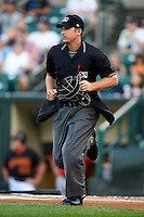 Umpire Mark Lollo during an International League game between the Empire State Yankees and Indianapolis Indians at Frontier Field on August 4, 2012 in Rochester, New York.  Empire State defeated Indianapolis 9-8 in ten innings.  (Mike Janes/Four Seam Images)
