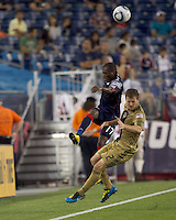 New England Revolution midfielder Sainey Nyassi (17) vollies pass downfield as Philadelphia Union defender Jordan Harvey (2) defends. The Philadelphia Union defeated New England Revolution, 2-1, at Gillette Stadium on August 28, 2010.