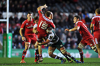 Andrew Conway of Munster Rugby is upended in a double-tackle by Ed Slater and Lachlan McCaffrey of Leicester Tigers. European Rugby Champions Cup match, between Leicester Tigers and Munster Rugby on December 20, 2015 at Welford Road in Leicester, England. Photo by: Patrick Khachfe / JMP