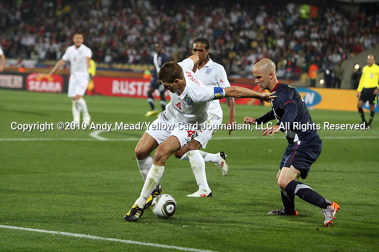 12 JUN 2010:  Steven Gerrard (ENG)(4) oversteps the ball as Michael Bradley (USA)(4) applies pressure.  The England National Team and the United States National Team were tied 1-1 after the first half at Royal Bafokeng Stadium in Rustenburg, South Africa in a 2010 FIFA World Cup Group C match.