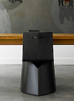 Detail of a designer black metal dining chair