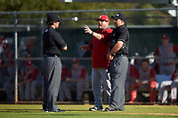 Indiana Hoosiers head coach Chris Lemonis argues a call with umpires Mike Savakinas (left) and Zach Tieche (right) during a game against the Illinois State Redbirds on March 4, 2016 at North Charlotte Regional Park in Port Charlotte, Florida.  Indiana defeated Illinois State 14-1.  (Mike Janes/Four Seam Images)