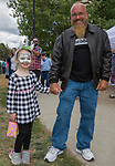 Ed Lane and 5-year-old Izzy during the Riverfest in downtown Reno, Nevada on Sunday, May 13, 2018.