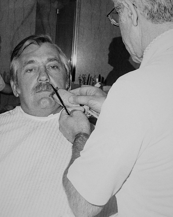 Rep. Silvio Ottavio Conte, R- Mass., House of Representatives Member receiving a trim of his moustache. (Photo by CQ Roll Call)